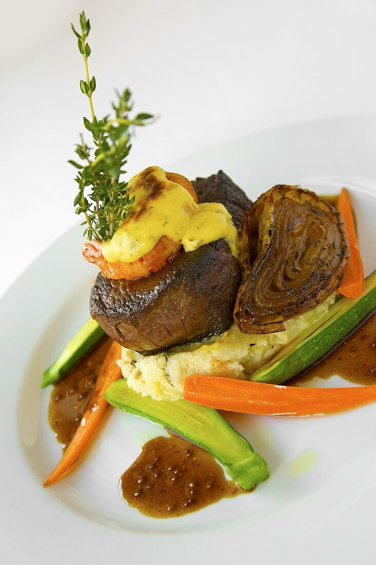 Steak Jolene: Beef Fillet with Prawn and Herb Infused Mashed Potato and Mustard Port Demi-Glace