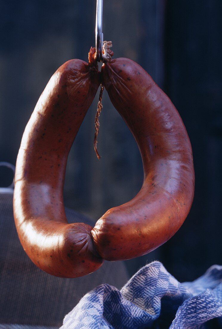 A Pair Lyon Sausages on a Hook
