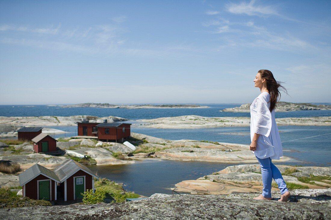 A woman on a rocky beach in Scandinavia