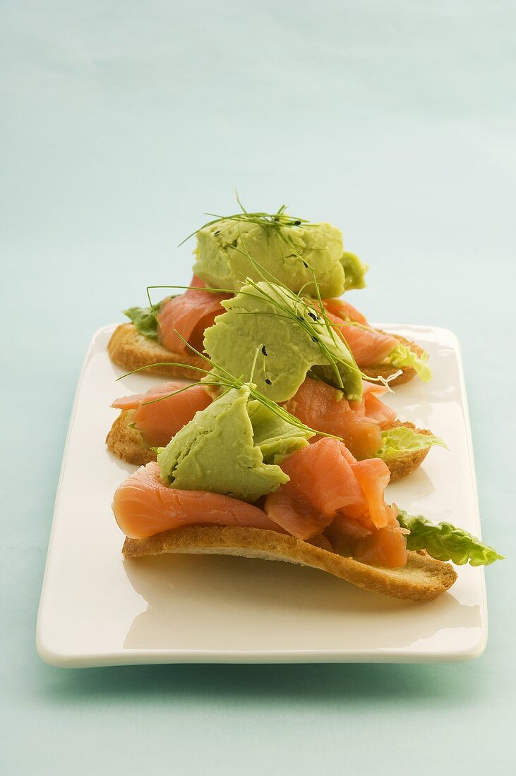 Canapes with avocado sorbet and smoked trout