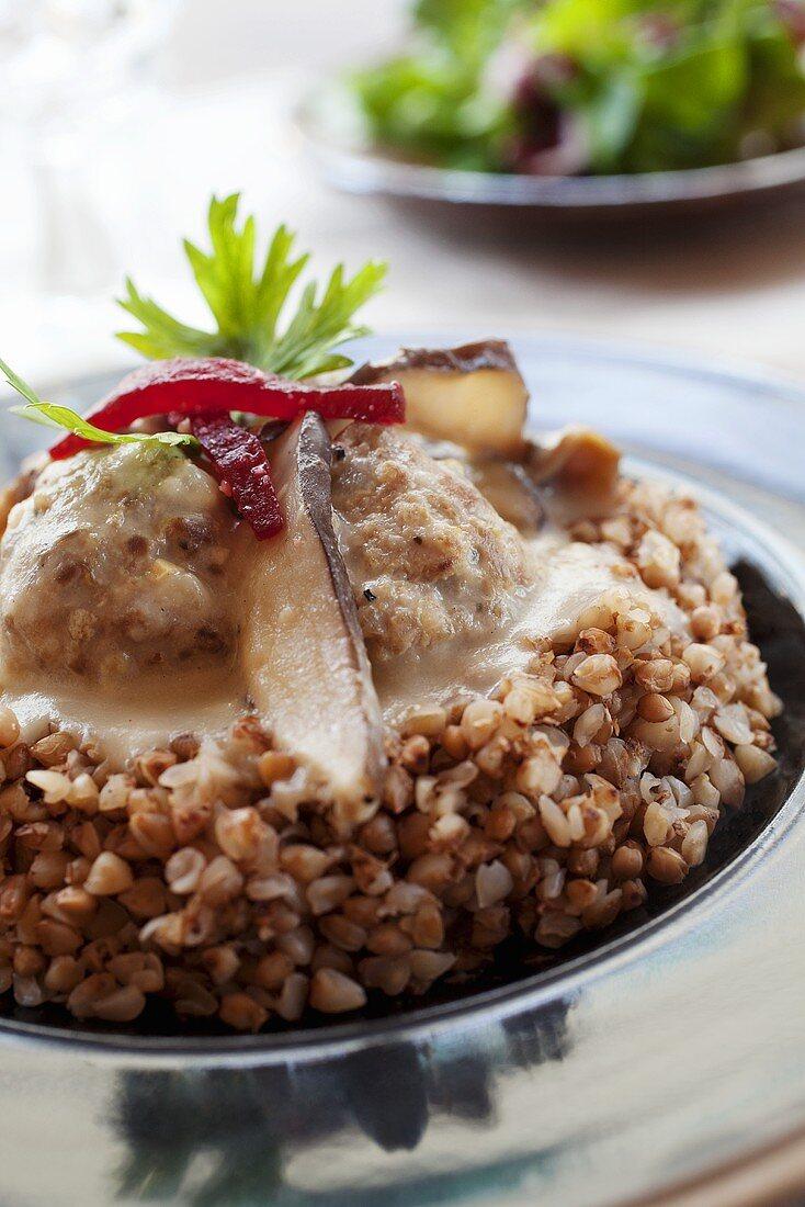 Meatballs with mushroom sauce on buckwheat