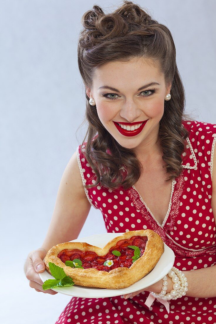 A retro-style gril with a heart-shaped puff pastry cake