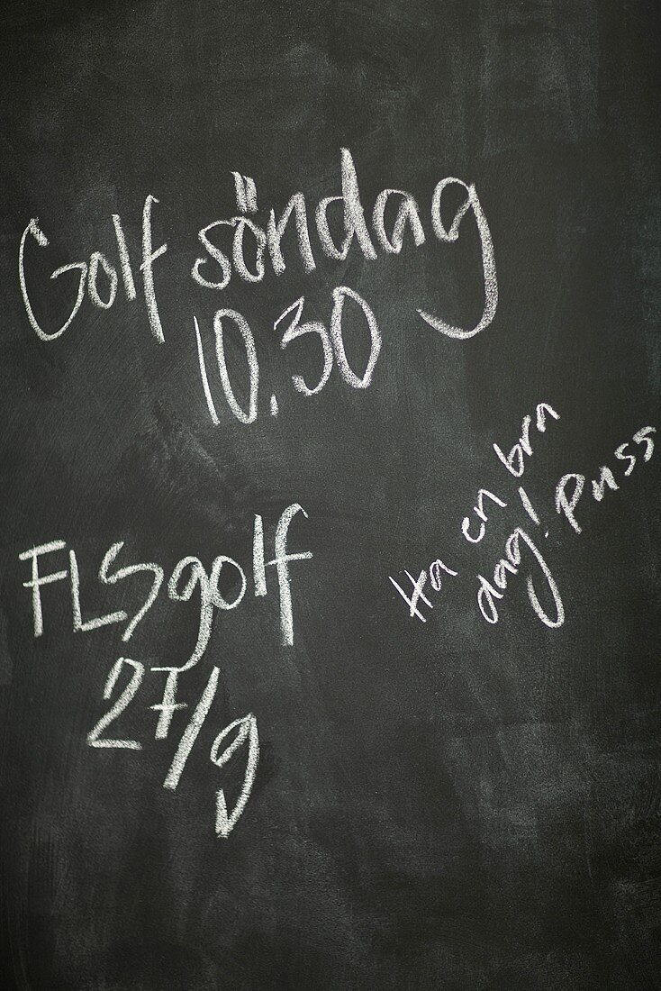 An invitation to play golf on a blackboard (Sweden)
