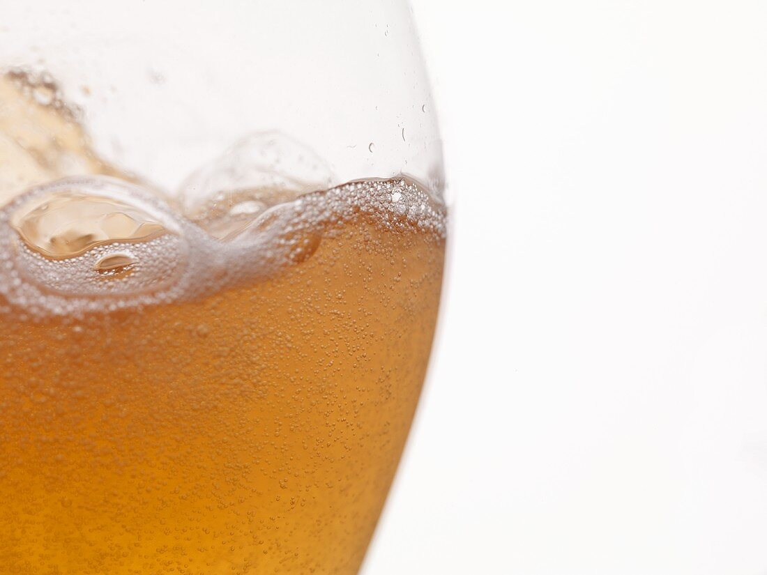 A glass of foamy cider