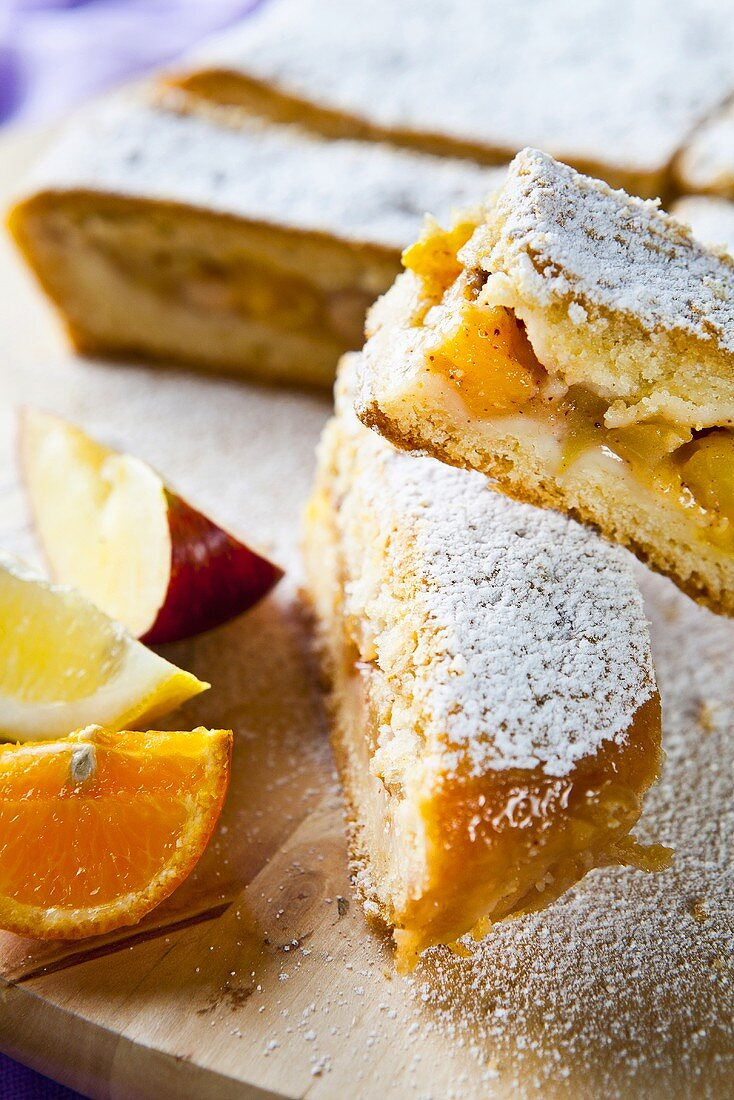 Fruit cake with apple, orange and lemon