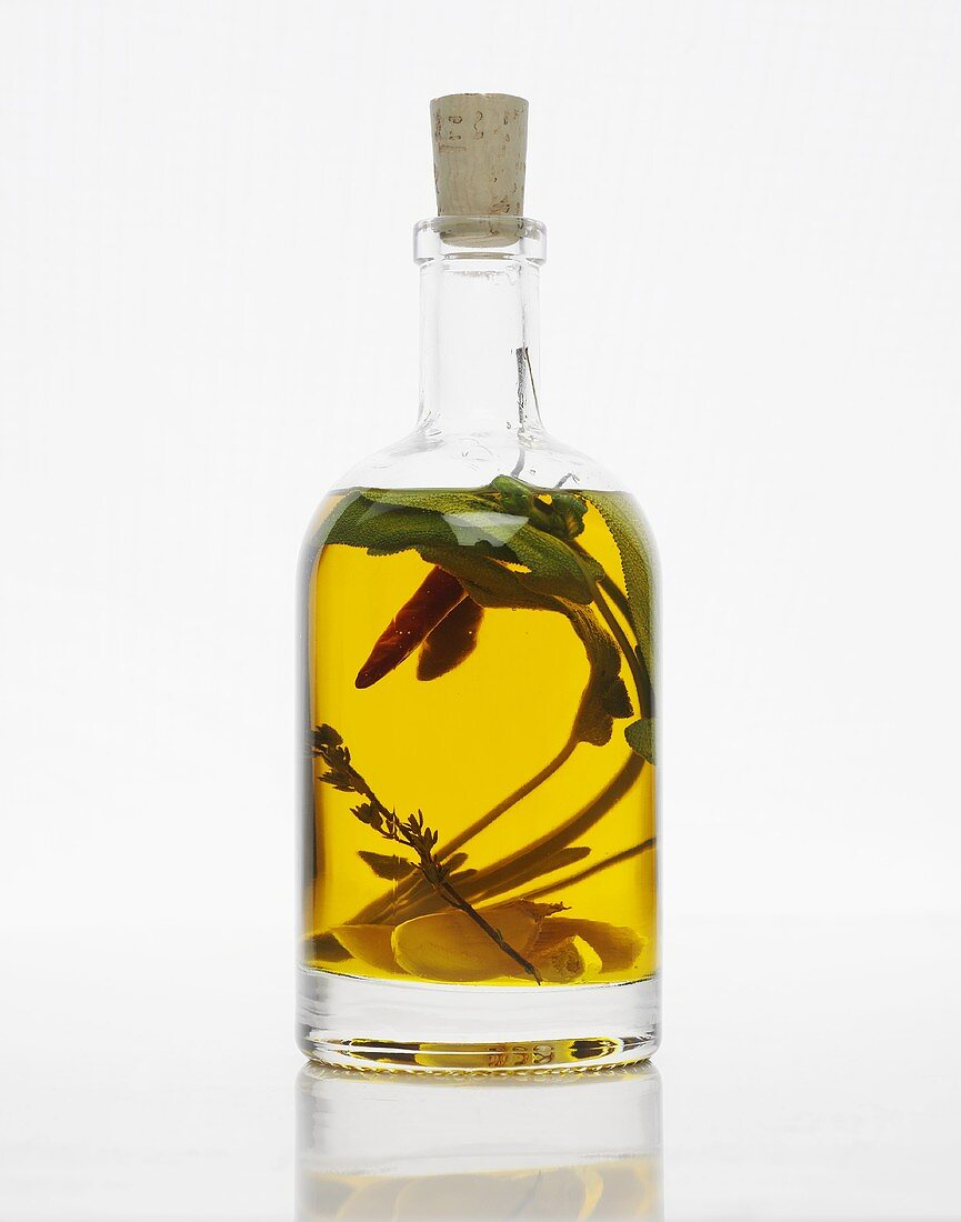 A bottle of herb oil with garlic and chillis