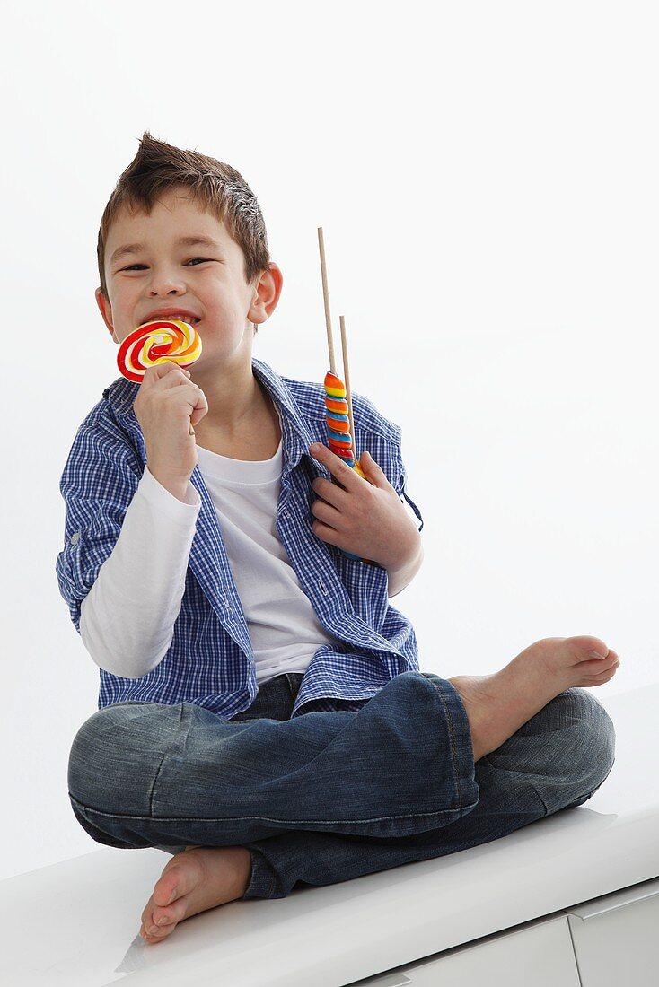 A little boy eating a lolly