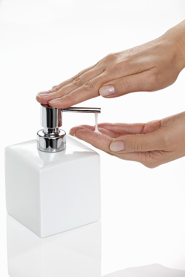 Liquid soap being pumped out of a soap dispenser