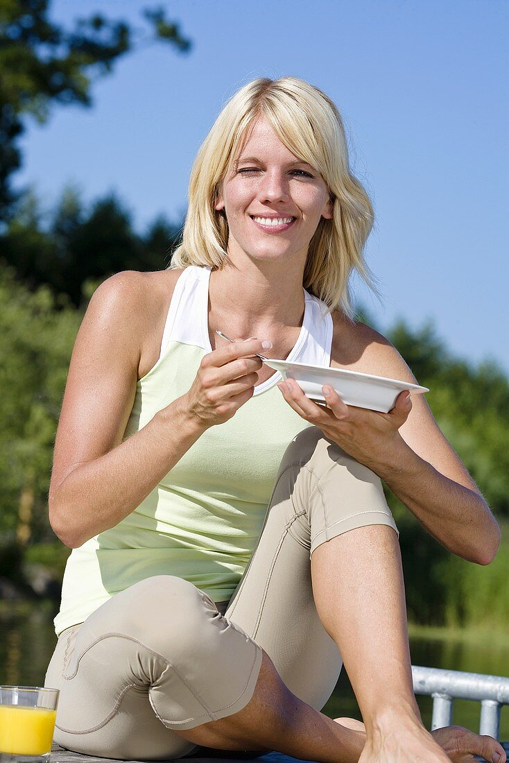 Blonde woman eating
