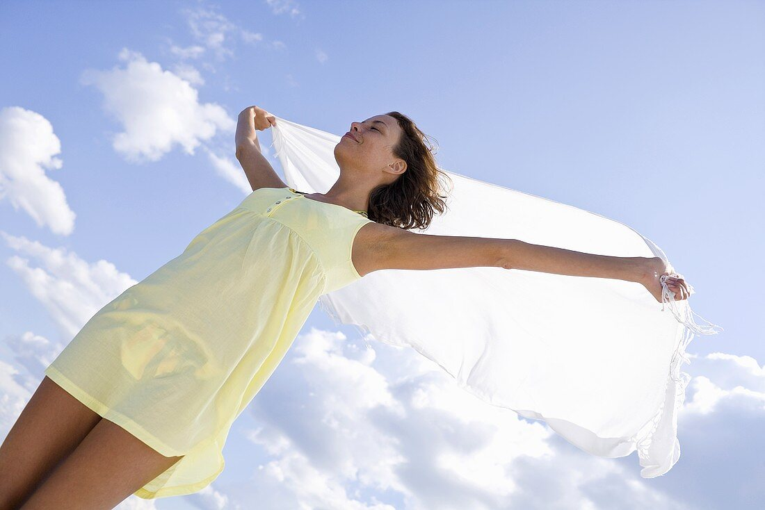 Women with a towel blowing in the wind