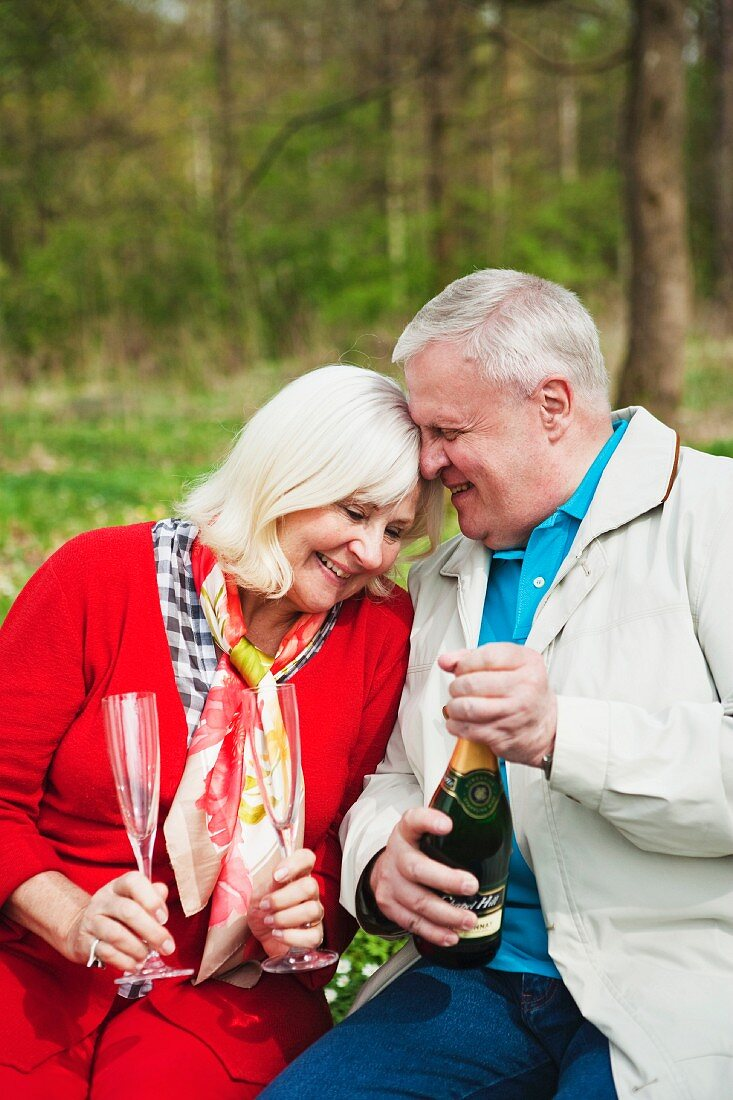 An older couple celebrating