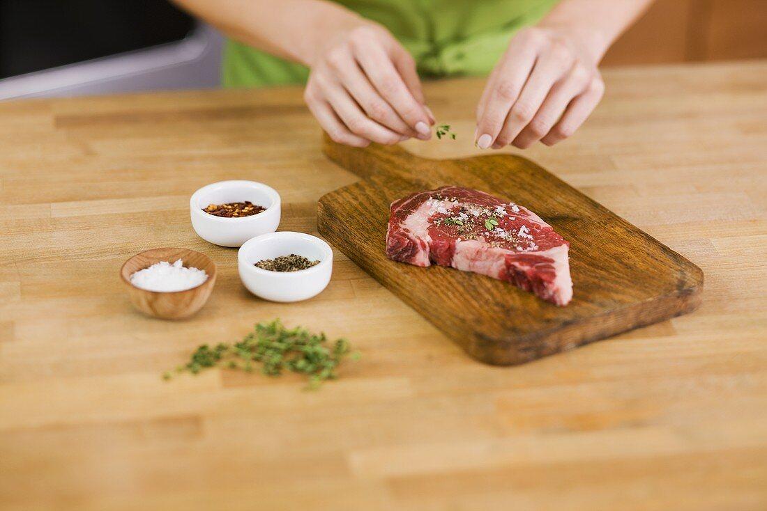 Woman Seasoning a Steak