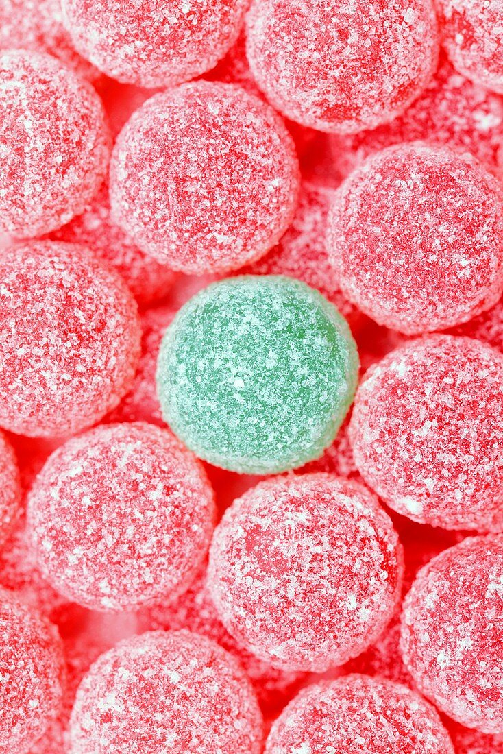 Pink jelly tots with a green jelly tot