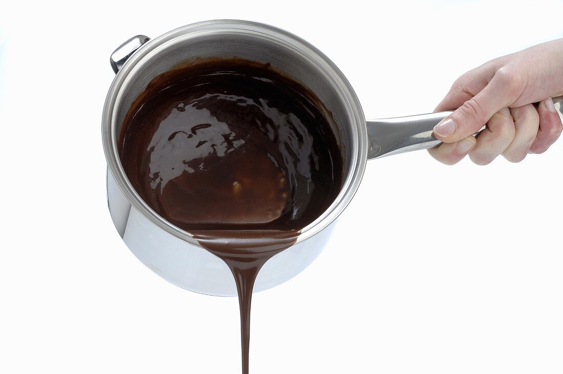 Pouring melted chocolate out of a pan