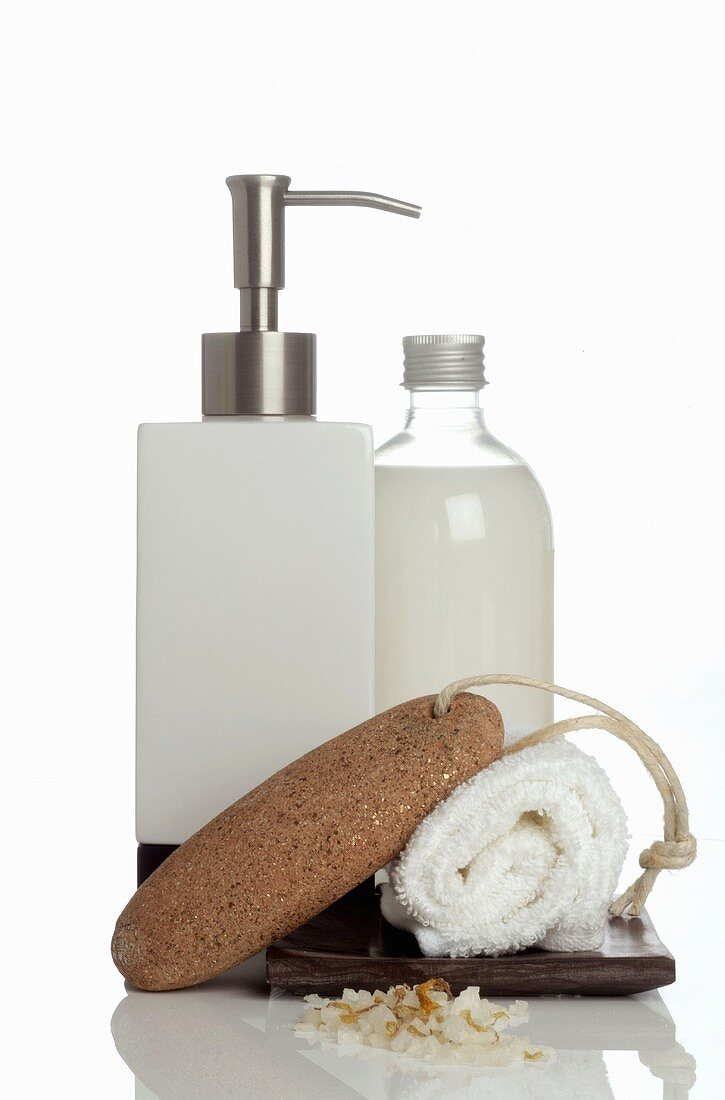 Liquid soap, pumice stone and towel