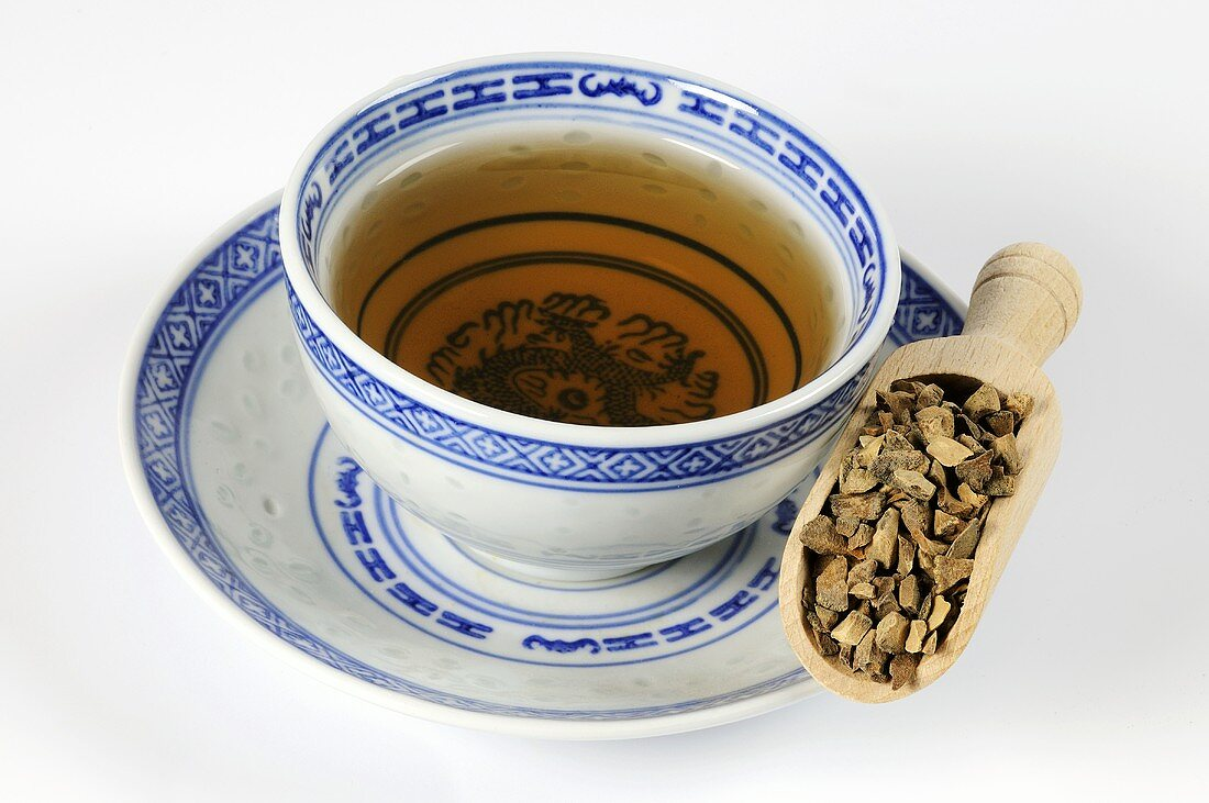 Bowl of tea with dried peel of the green Curaçao orange