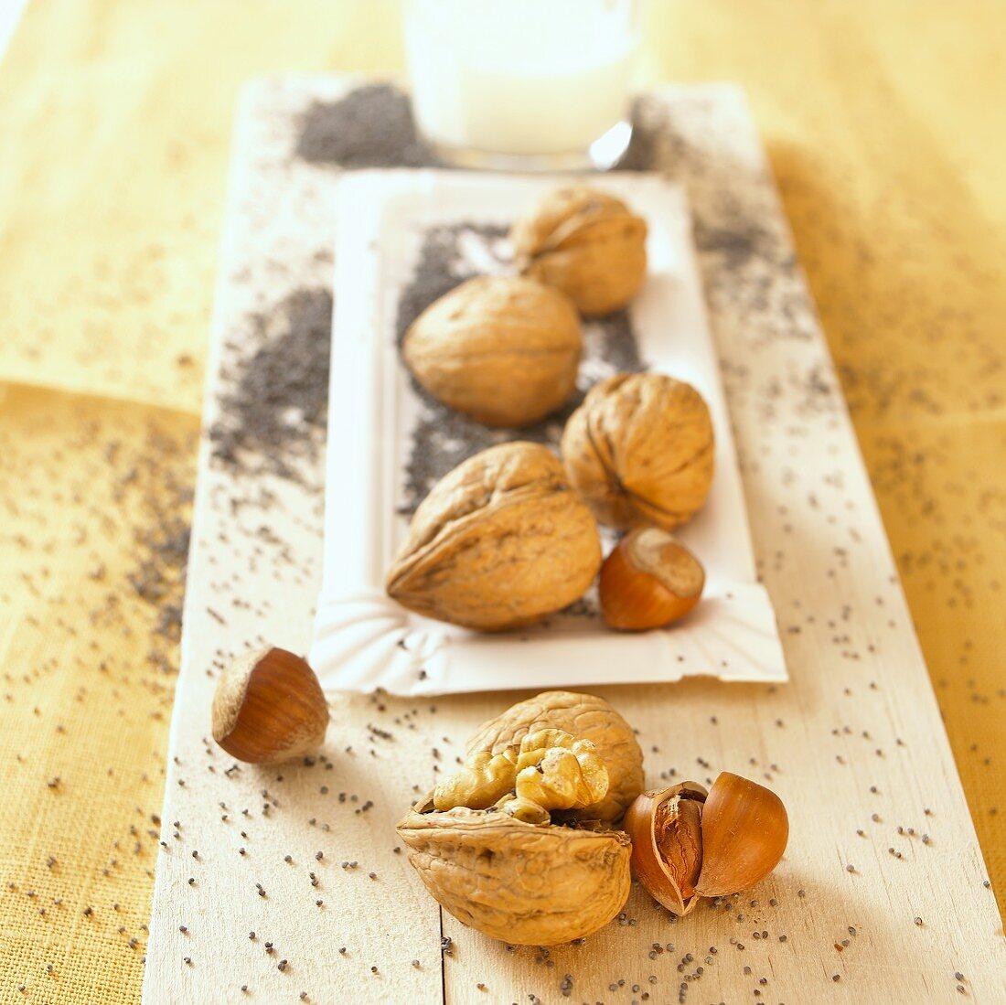Hazelnuts, walnuts and poppy seeds with a glass of milk