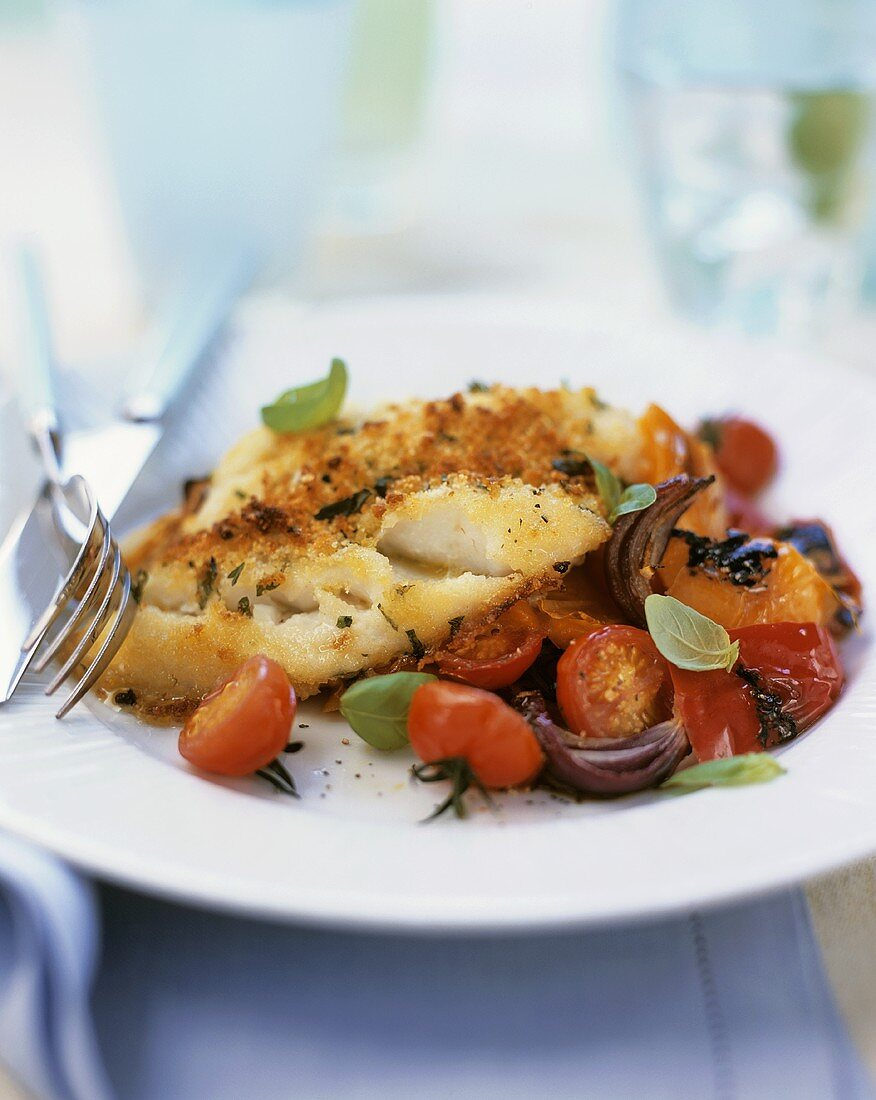 Cod with herb crust on tomatoes