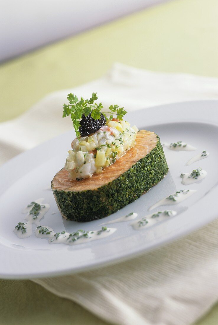 Salmon in herb coating with vegetables and caviar