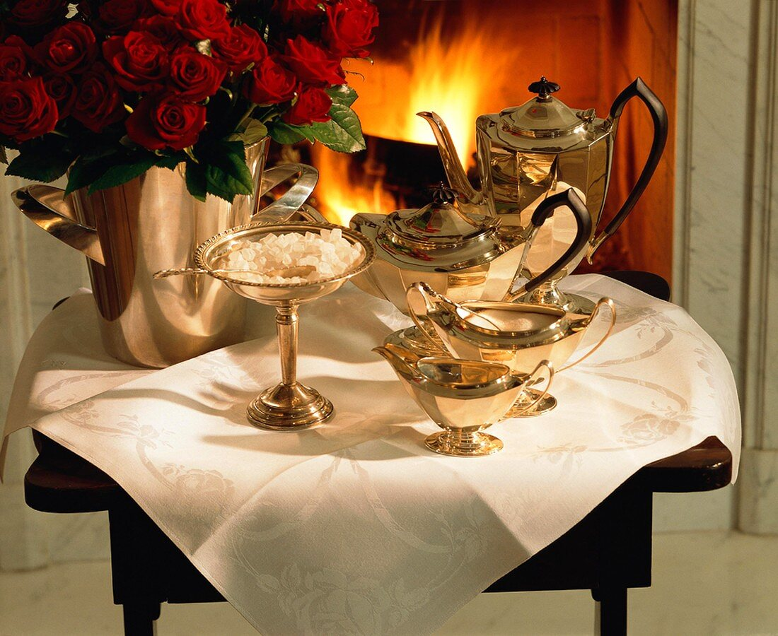 Silver Tea Set; Table in Front of Fireplace