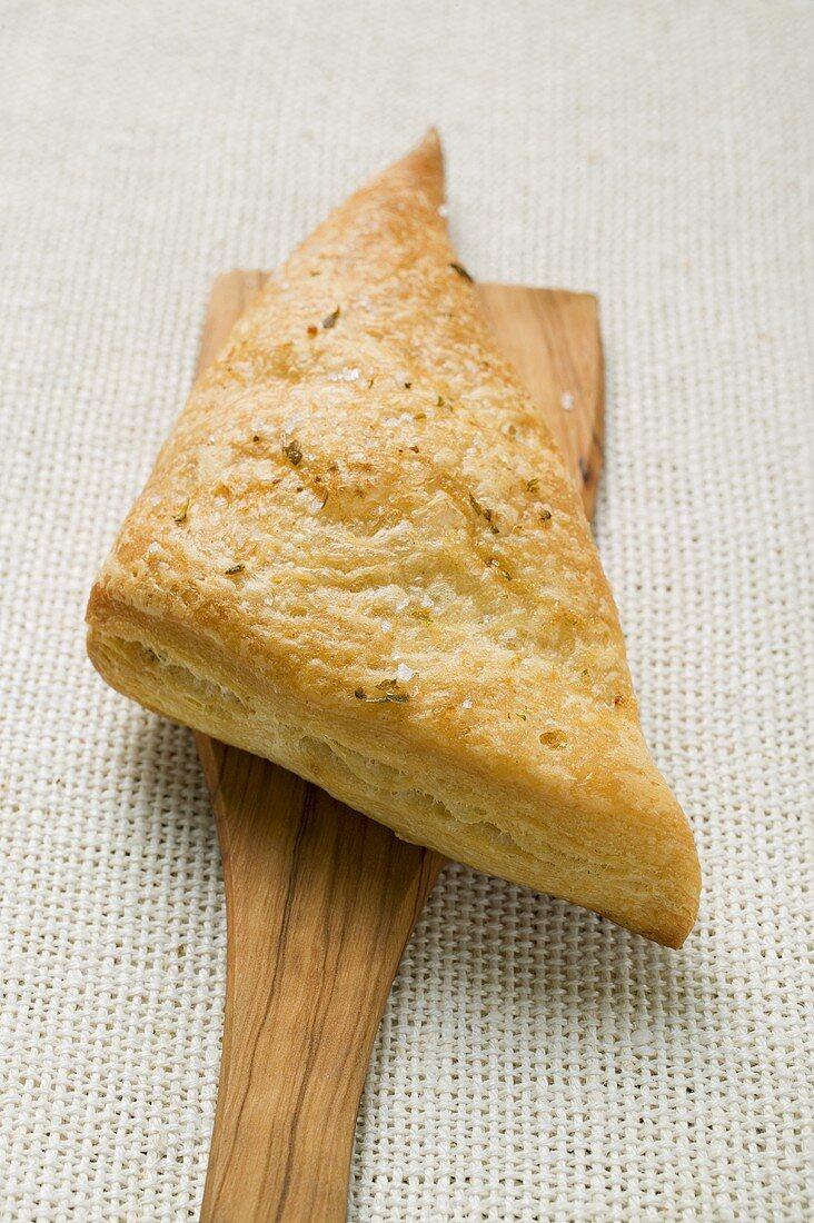 Triangular savoury puff pastry pasty on server