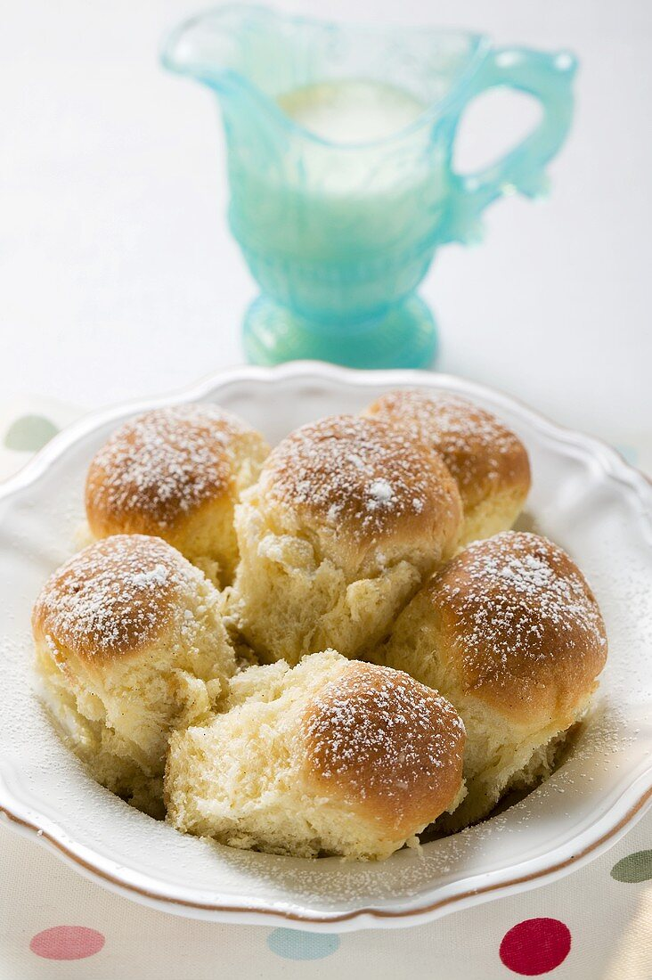 Sweet yeast dumplings (Buchteln) with icing sugar & custard