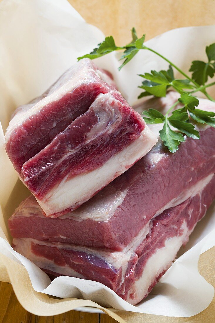 Fresh beef with parsley on paper