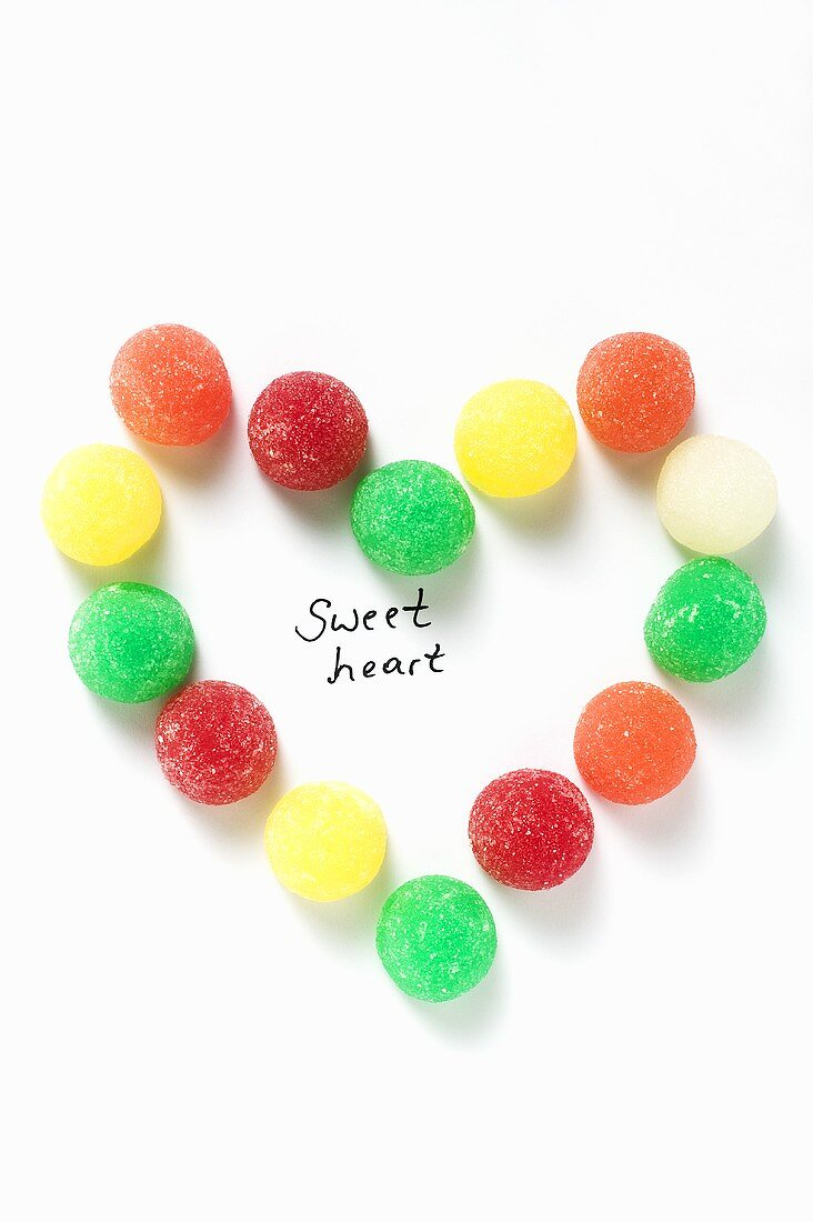Coloured jelly sweets forming heart with the words 'Sweet heart'