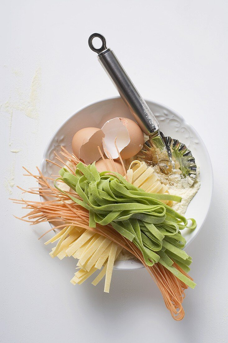 Home-made pasta, ingredients and pasta wheel