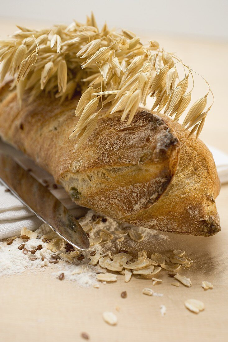 Wholemeal baguette with cereal ears and ingredients