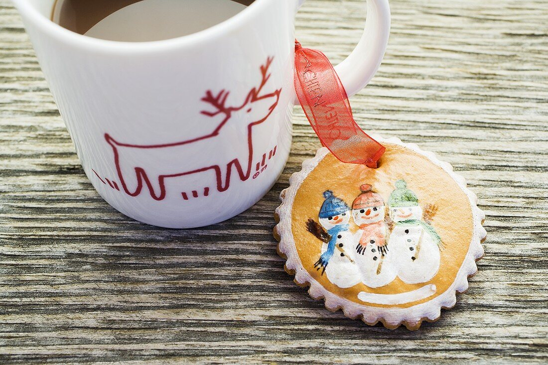 Gingerbread tree ornament and cup of cocoa