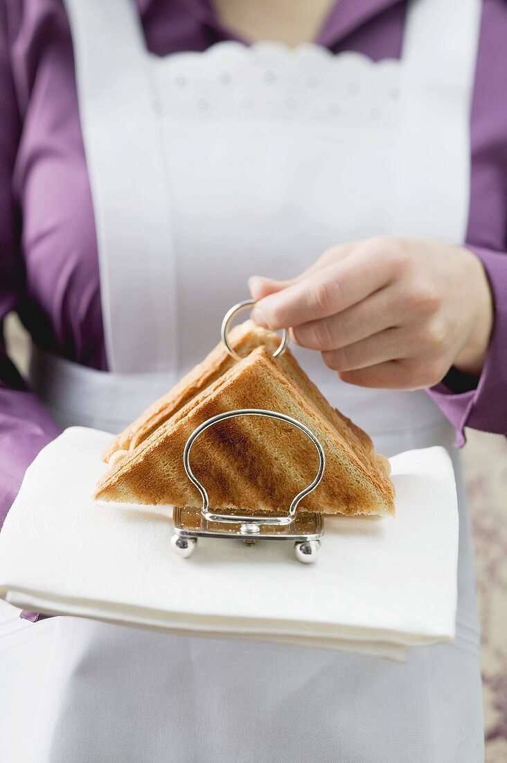 Chambermaid serving toast