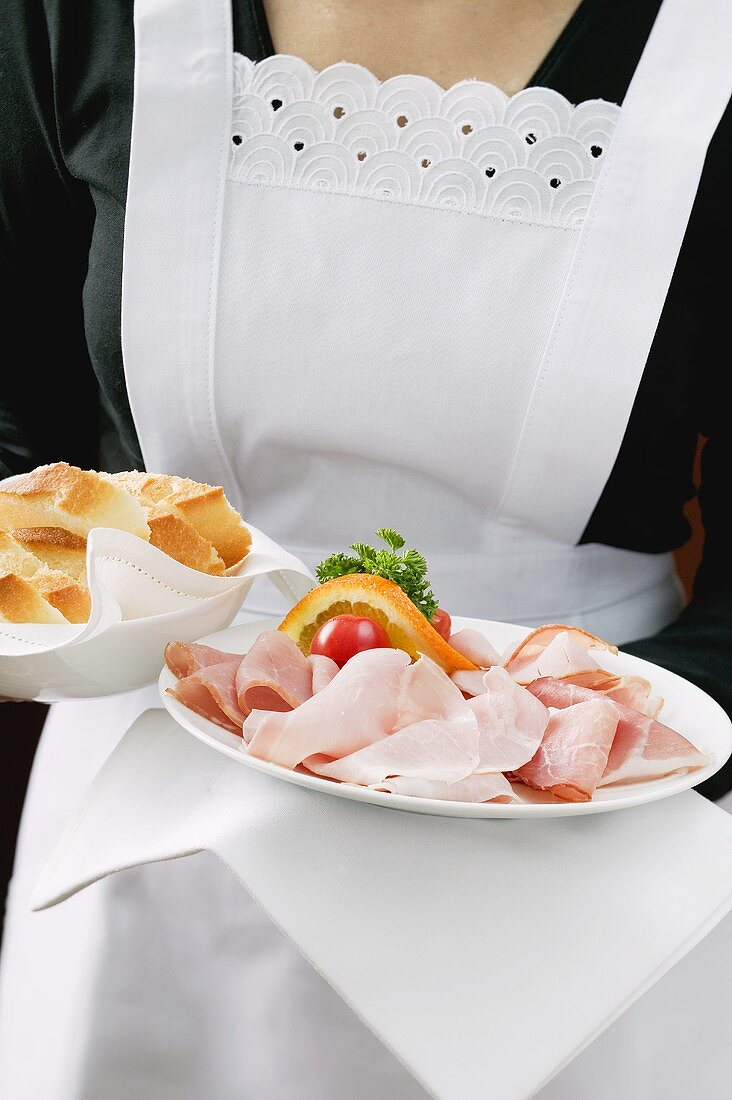 Waitress serving ham and white bread