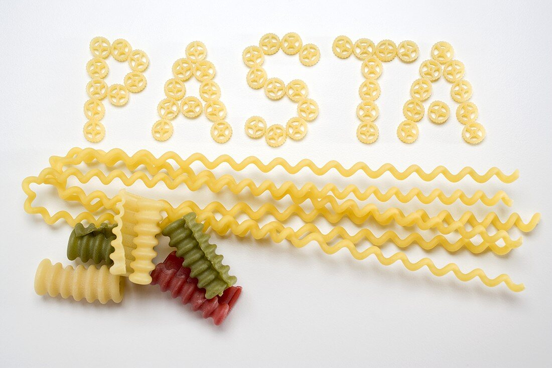 Wagon wheel pasta (the word 'Pasta), fusilli lunghi, riccioli