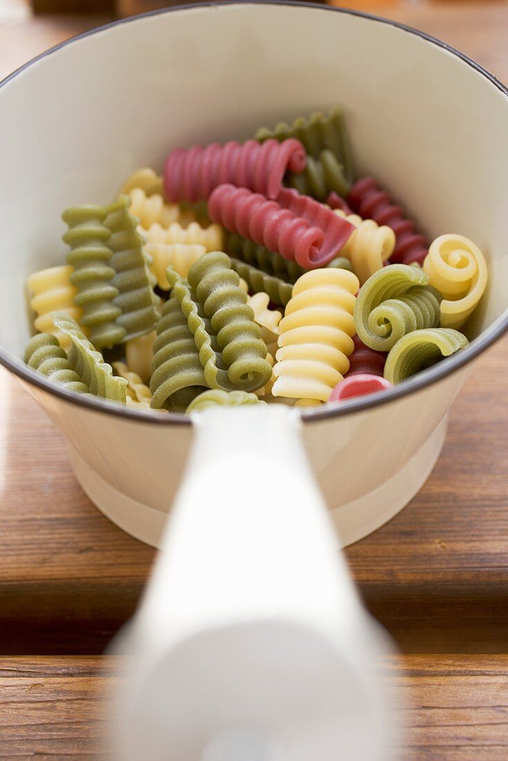 Coloured riccioli in strainer