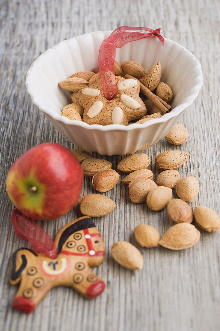 Gingerbread tree ornaments, almonds and apple