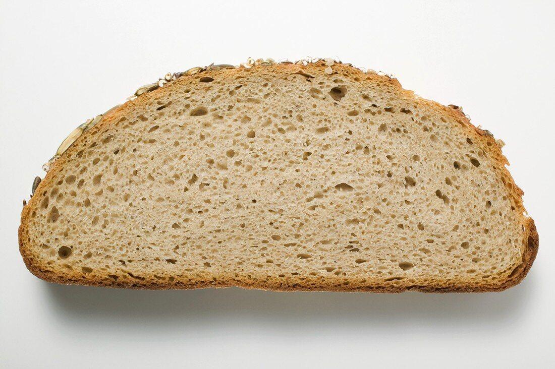 Slice of pumpkin seed bread