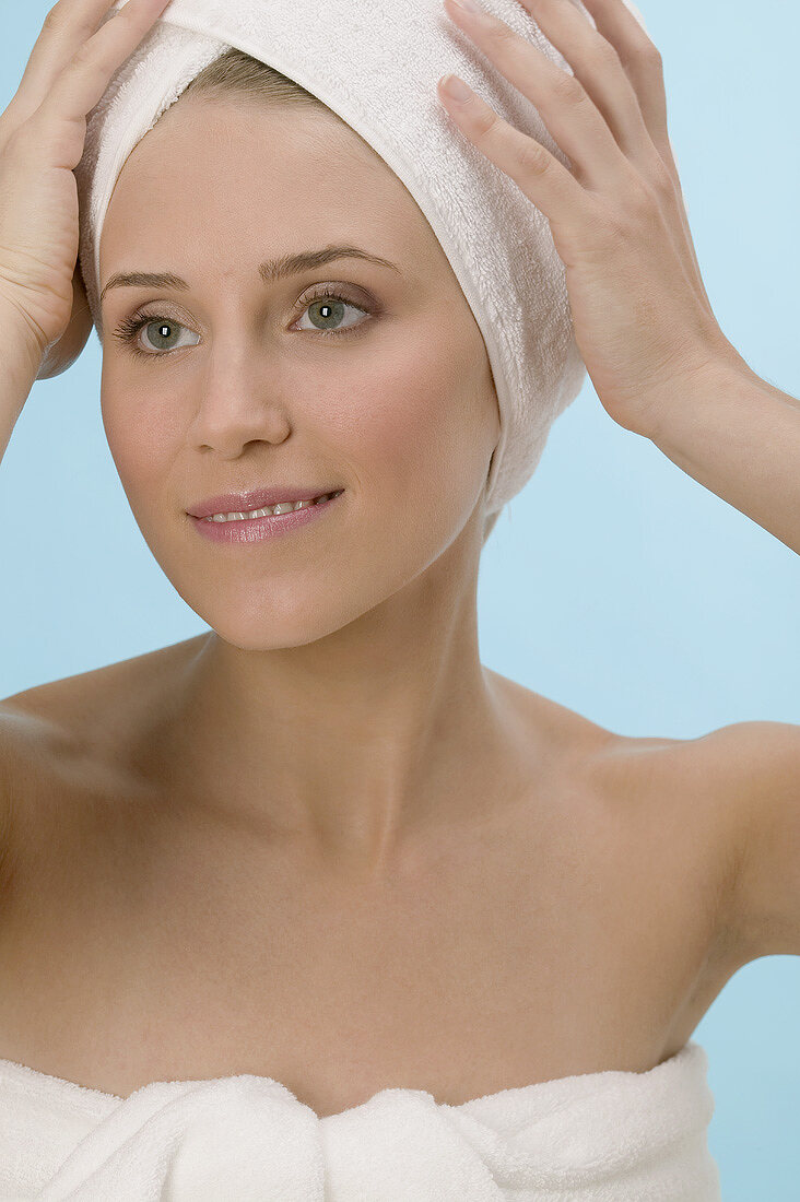 Woman with her hair wrapped in a towel