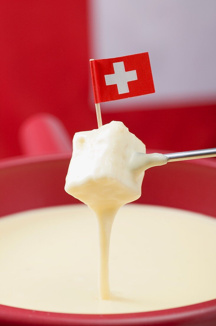 Cheese fondue with Swiss flag (close-up)