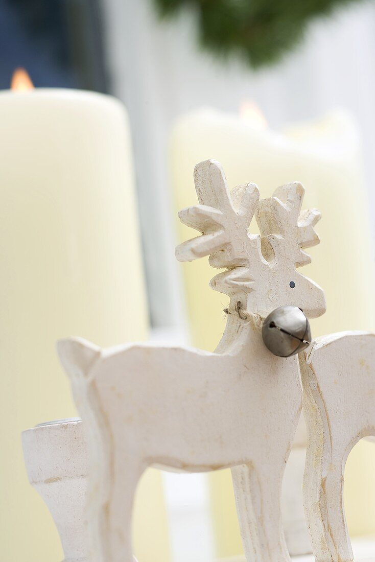 Christmas decoration: white candles and reindeer