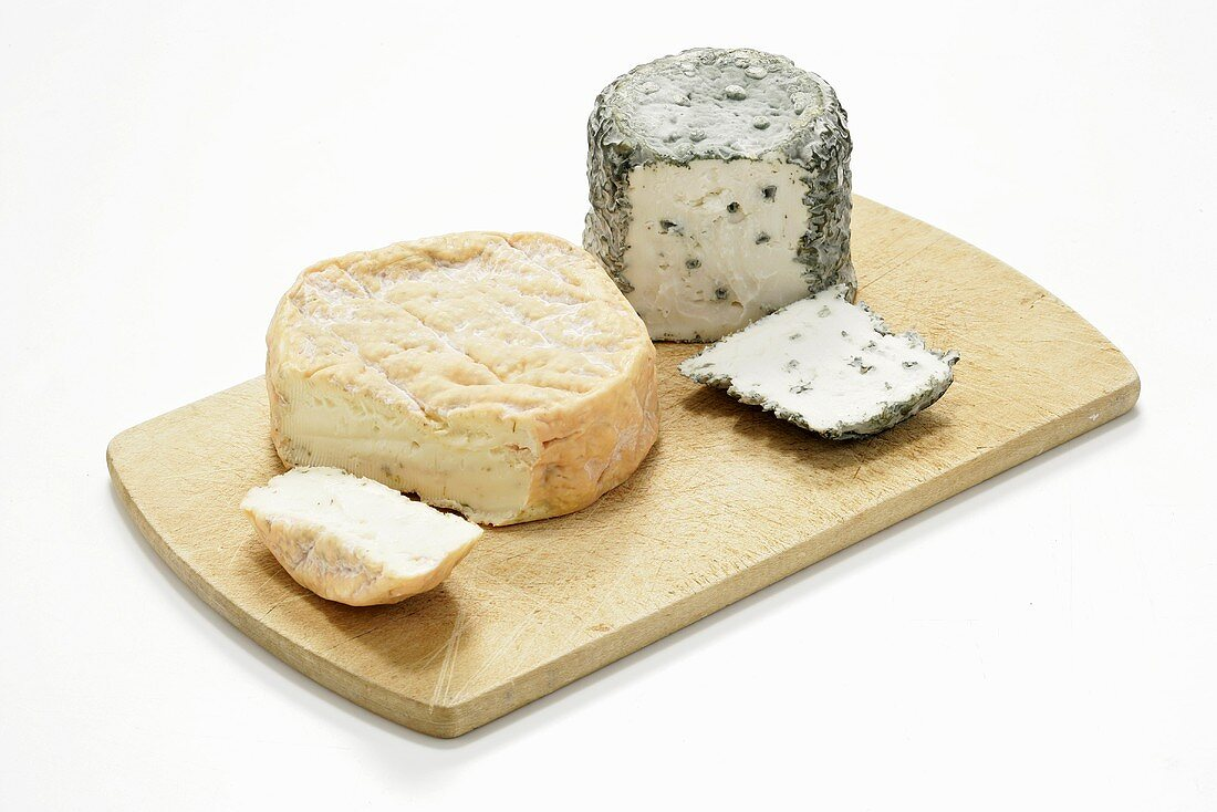 Two different raw milk cheeses on chopping board