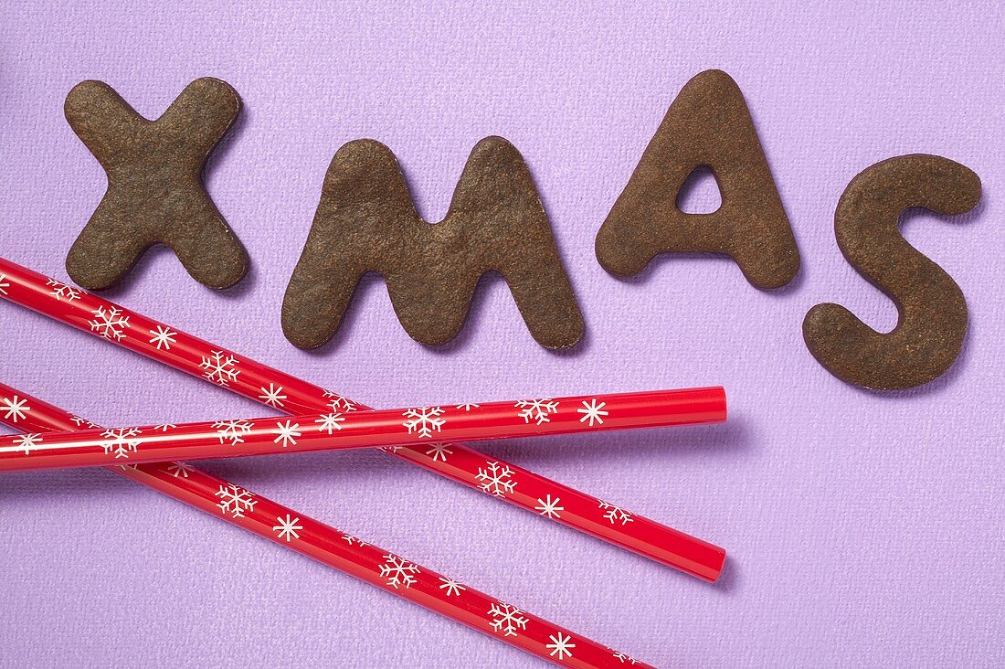 Letter biscuits (spelling the word XMAS) and straws