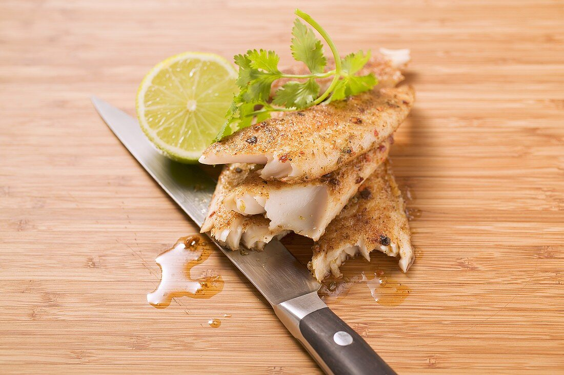 Spicy pangasius fillet with lime and coriander leaves