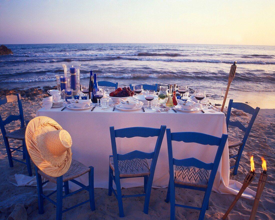 Laid table on the beach at twilight