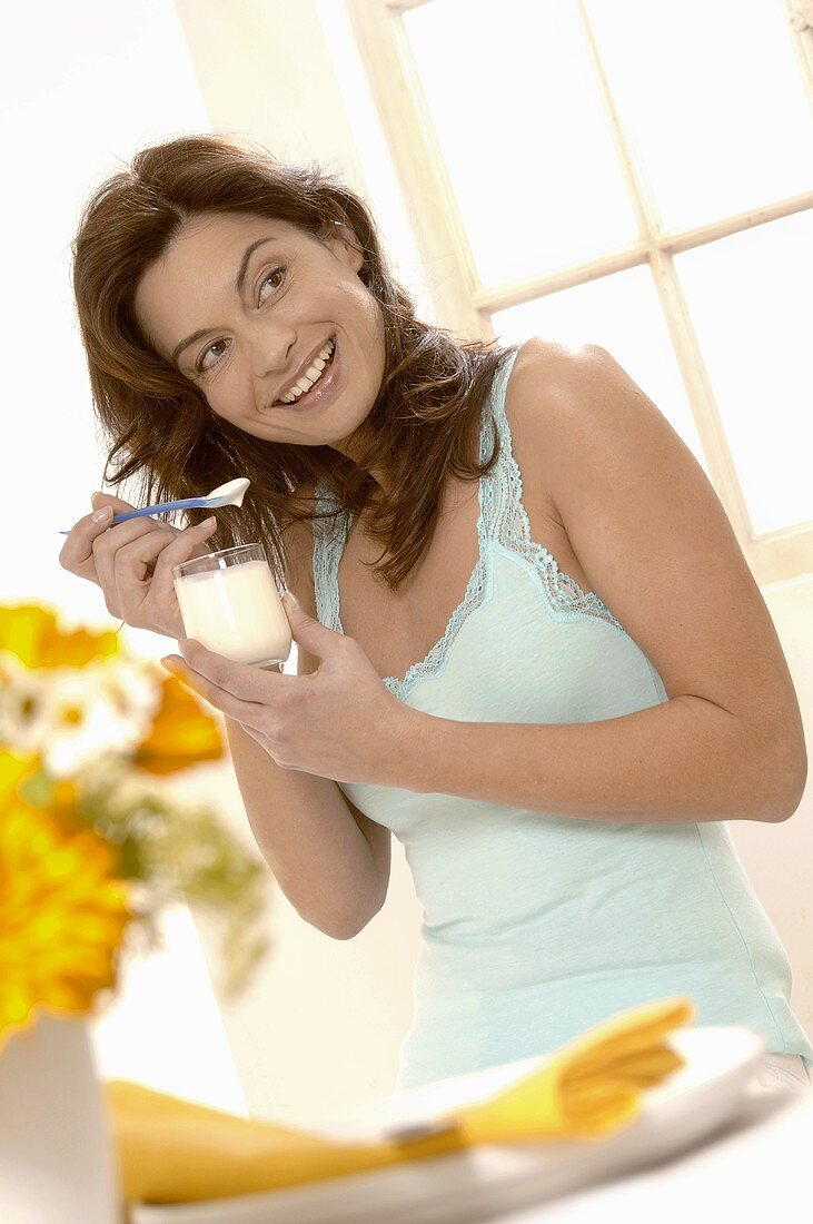 Woman eating natural yoghurt