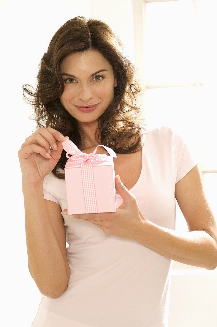 Woman holding gift in her hand
