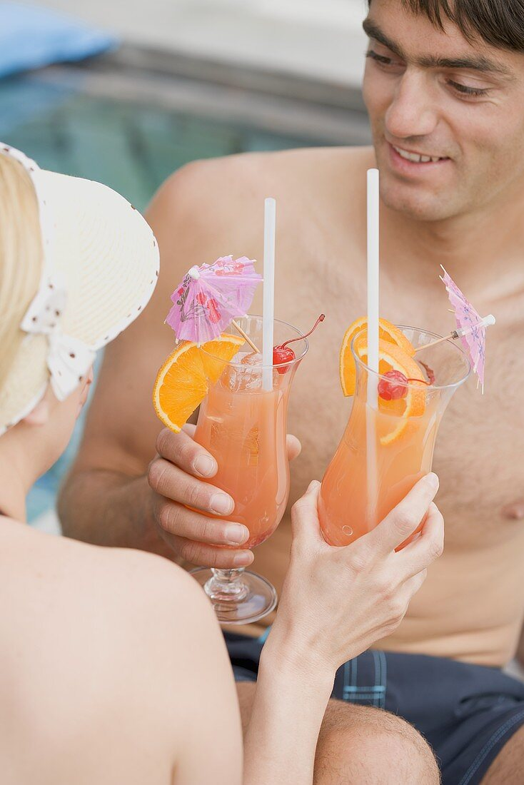 Man and woman with Planter's Punch by pool