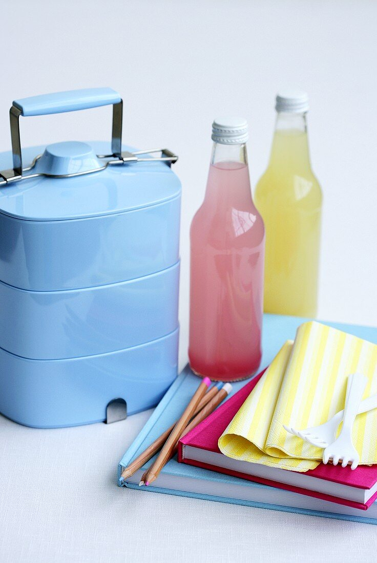 A lunchbox and drinks for school