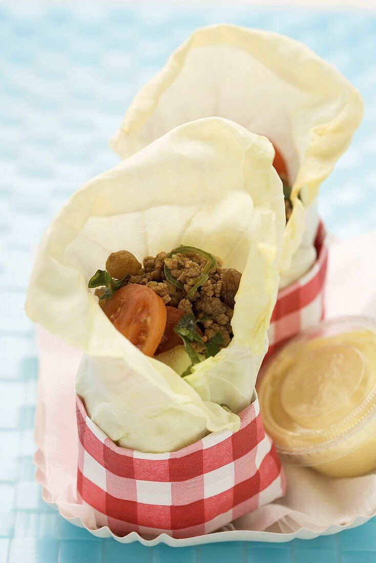 Serbian white cabbage wraps with minced meat and tomatoes
