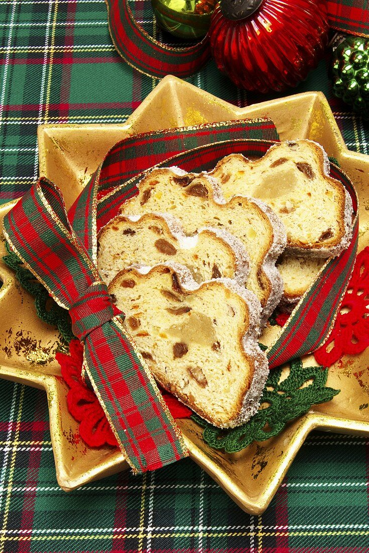 Marzipan stollen, cut up on a star-shaped plate